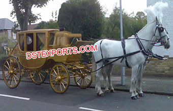 Golden Covered Horse Drawn Carriage