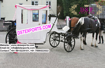 White Antique Horse Drawn Carriage
